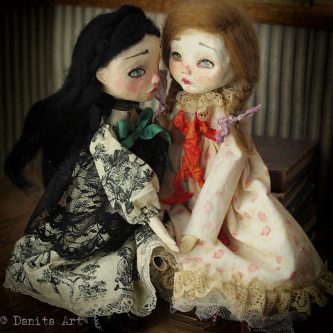 These astonishingly beautiful art dolls with sculpted paper clay faces are made by Danita Art.