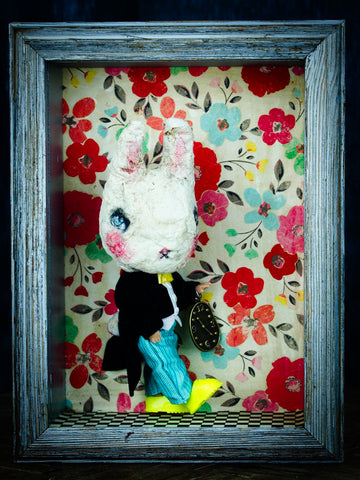 The white rabbit is reinterpreted as a cute but dark bunny by the crafty hands of Danita in her fantastic Bunnies in Wonderland series