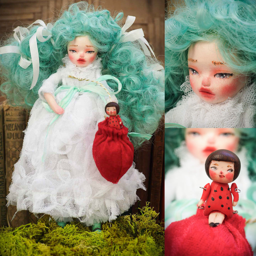 Little girl wanted to peek into Santa's toy sack that she stole it for herself. Now this little art doll by Danita art with a white hand made gown, polymer clay mini-doll and a snowman can be yours to adopt or buy.
