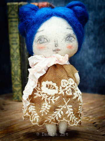 A lovely mini art doll, created by Danita Art using simple materials like felted wool, hand dyed lace, ribbon and colored pencils for their lively faces.