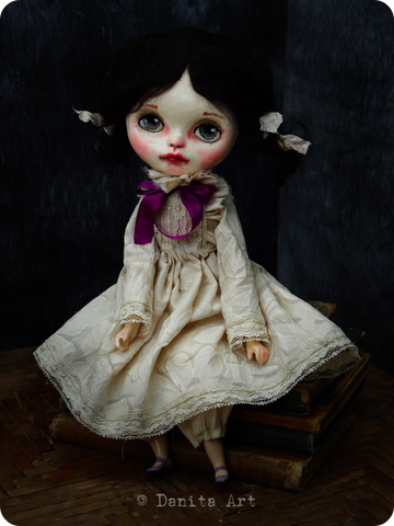 Renata, the art doll by Danita Art has beautiful and expressive eyes, hand painted face and a hand crafted fabric body and clothes.
