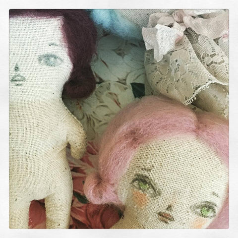 Muslin hand crafted art dolls in progress, on the table of mixed media artist Danita Art