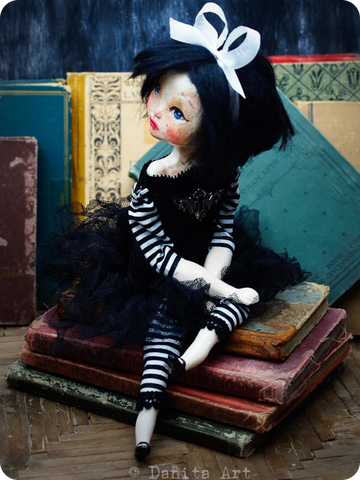 Marielena is a punk rocker girl, she owns the key to her own heart and will be always free. She is a handmade art doll created by the talented hands of Danita Art, mixed media artist.
