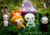 An amazing collection of hand crafted needle felting fabric and wool art dolls by the amazing mixed media artist and doll maker Danita Art