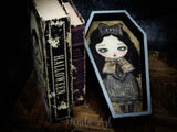 This vampire girl in a wood coffin was painted by Danita Art