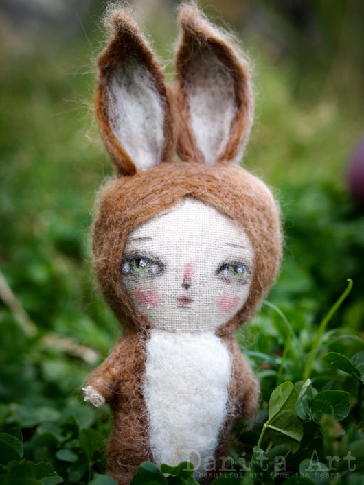 A needle felting woll and fabric bunny rabbit art doll, handmade by the amazing mixed media artist and doll maker, Danita Art