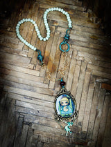 Alice in wonderland is featured on this necklace, handcrafted by Danita Art.
