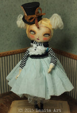 An amazing art doll handmade by Danita Art, Alice in Wonderland wearing the mad hatter's hat.