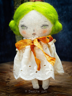 Danita's hand made fabric art dolls will mesmerize you with their beautiful eyes and simple dresses.