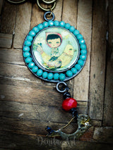A beautiful necklace and bird pendant by Danita Art