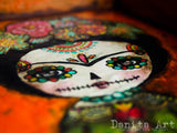 Frida Kahlo shines as a colorful sugar skull on this original mixed media collage painting by Danita Art