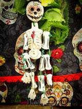 Colorful patterns adorn this hand made paperclay art doll featuring Frida Kahlo as the painted skull La Catrina, made by Danita Art