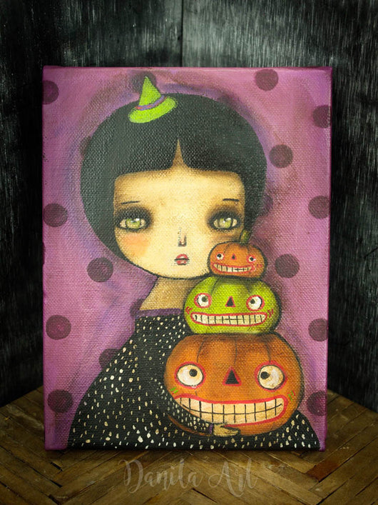 Witches also have their pumpkin contests every Halloween! And this little girl is getting ready to showcase her best pumpkins On this mixed media painting on canvas by Danita Art