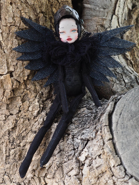 Inspired by a fascination with the Raven by Edgar Allan Poe, I made this original Danita art doll with air dry clay for head and fabric pieces for her body and wings. She is also wearing a mask you can remove if you wish.