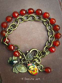 A beautiful mixed media bracelet created by the hands of Danita Art.