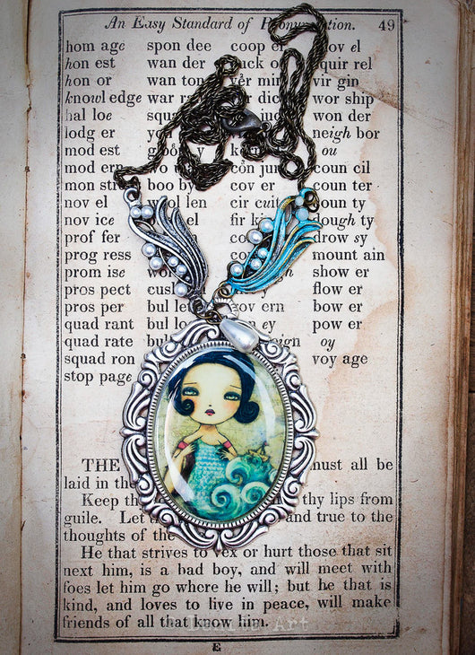 The knitter of the sea is a surreal image turned into a beautiful necklace by Danita Art