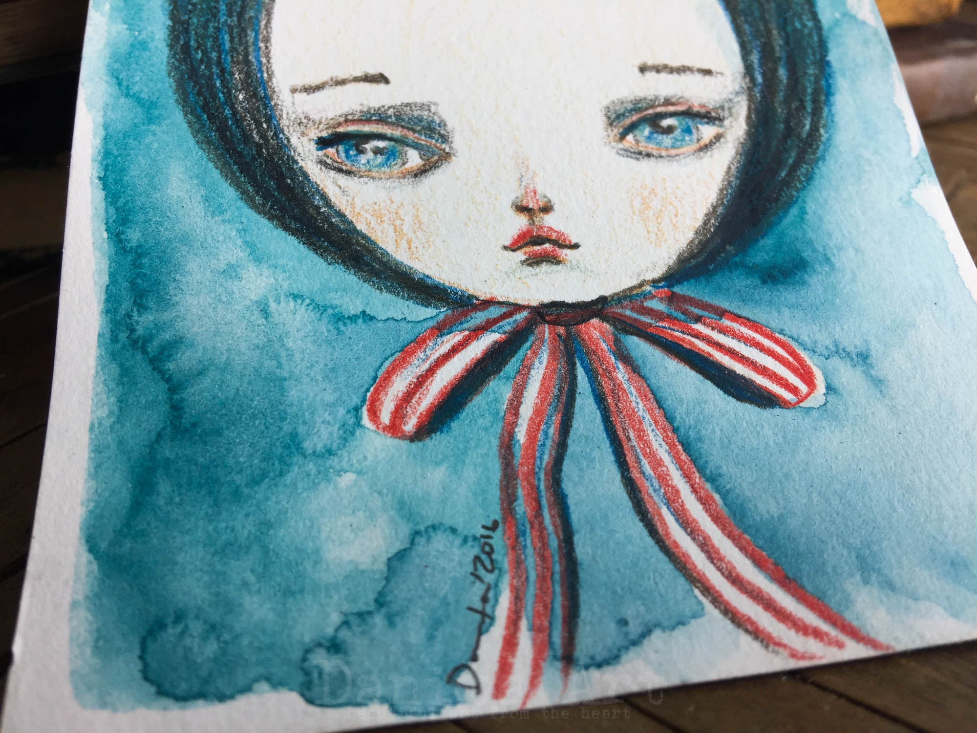 Study of a girl with a red bow, watercolor on paper original by Danita.