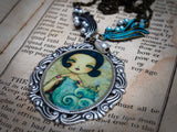 The goddess of the sea is knitting the ocean waves on this hand made necklace and pendant by Danita Art