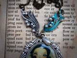 The ocean waves and a mermaid goddess come to like on this unique and original necklace, a unique piece of wearable art created by mixed media artist Danita