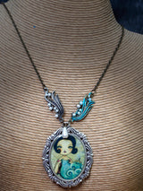 A simple metal chain is the perfect compliment for this elegant pendant and necklace ocean themed wearable artwork by mixed media artist Danita