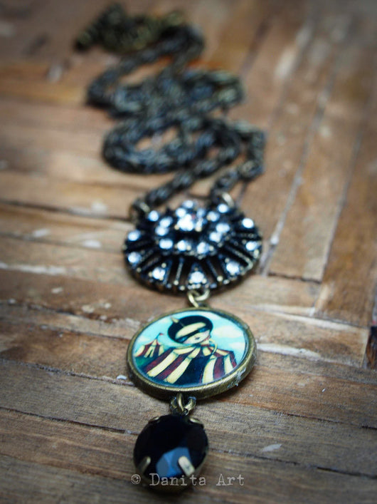 The discovery is a surreal image inspired by the magic and mystery of the circus and carnivals, and the rush of self discovery when you are young. Feel free and careless again when you ear this handmade necklace by Danita.