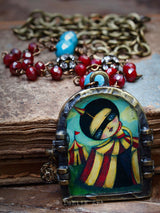 The discovery is one of Danita's favorite images. She turned it into a handmade necklace with beautiful details like an antique brass chain, red and turquoise faceted beads and a little gold mica charm.