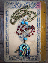 Danita's magical handmade jewelry compels you to wear it, with luscious and surreal mixed media images, glass and natural stone faceted beads and antique brass chains.