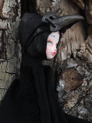 THE PLAGUE DOCTOR is a handmade Halloween art doll created by Danita Art. Using air dried clay, found fabrics and needle stitching for her body, Danita created an amazing original piece of work.