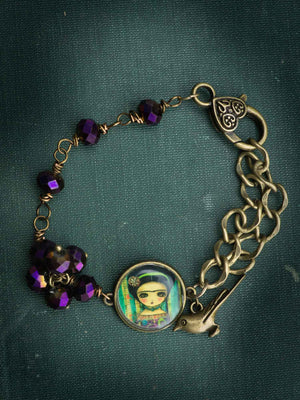 Original Bracelet By Danita Art. Frida Kahlo painting with bird and purple glass beads.