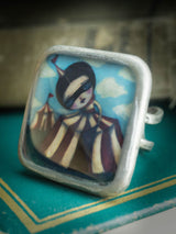 Danita creates beautiful one of a kind pieces of handcrafted jewelry like this square ring with a surreal circus image from Danita.