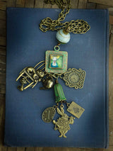 Danita made a beautiful Alice in wonderland necklace with a square metal setting and lots of metal charms.