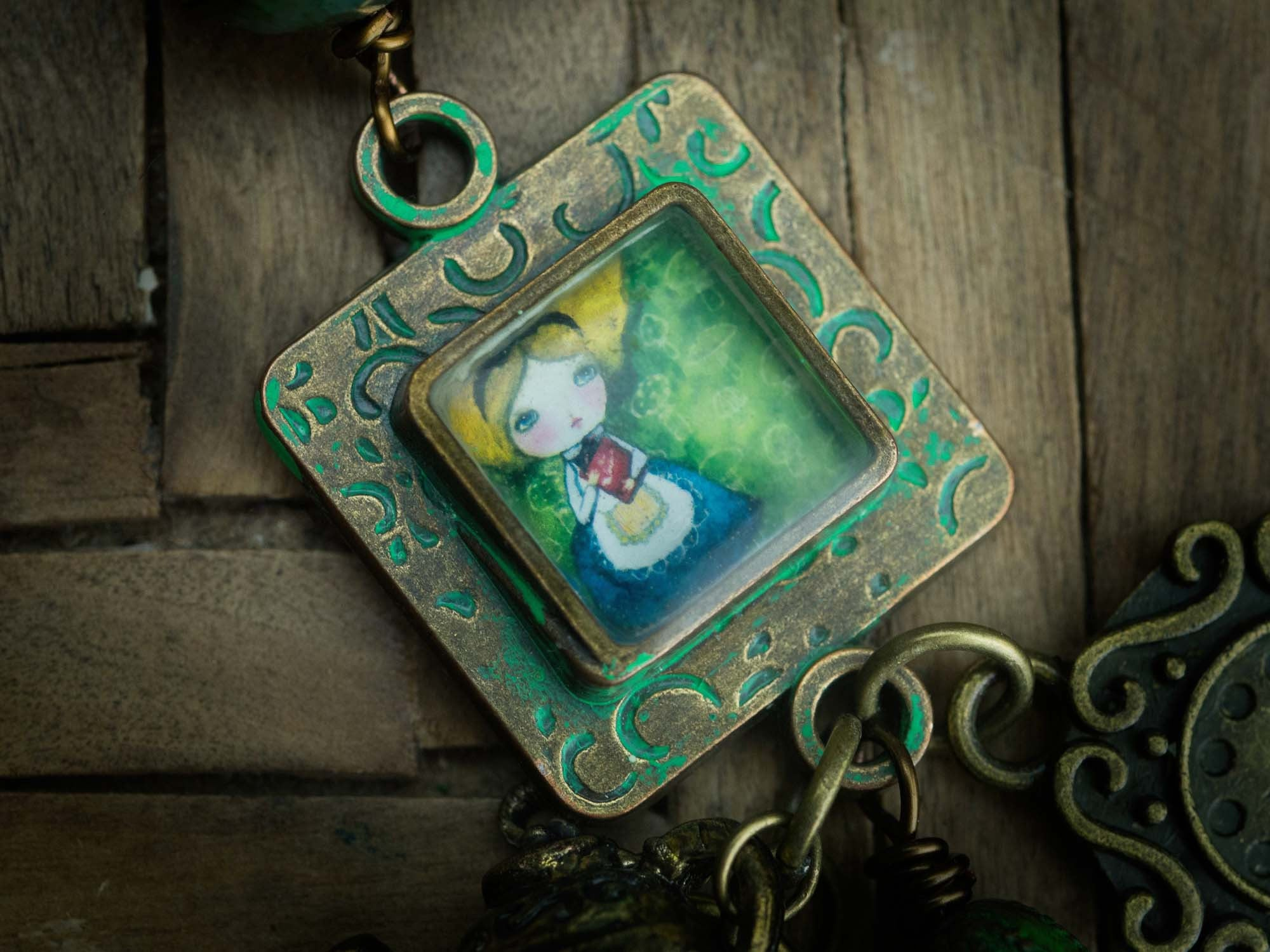 Danita's Alice in Wonderland mixed media painting lives on this square handmade pendant.