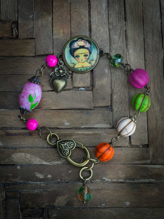 Danita created an amazing and colorful bracelet with Frida Kahlo painted by her.