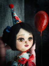 Danita writes dollmaking techniques and tutorials to create beautiful art dolls like this girl with wool felted black hair and amazing, alive brown glass eyes