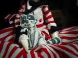 Candy Candy pet raccoon follows ger everywhere she goes on this art doll by Danita Art