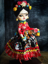 Danita created a beautiful handmade art doll using a colorful fabric inspired by the day of the dead.