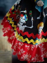Each element on Danita's art dolls is carefully chosen and crafted, like this skirt inspired by the day of the dead.