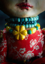 The same attention to detail that Danita puts to her original handmade jewelry was put to the accessories that this handcrafted Frida doll wears