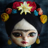 Paper flowers, colorful themes and the most beautiful eyes mix on this unique art doll by Danita.