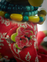 even the buttons holding the arms of this Frida art doll by Danita Art are special.
