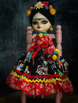 Frida Kahlo sits proud and beautiful on this handmade art doll by Danita Art