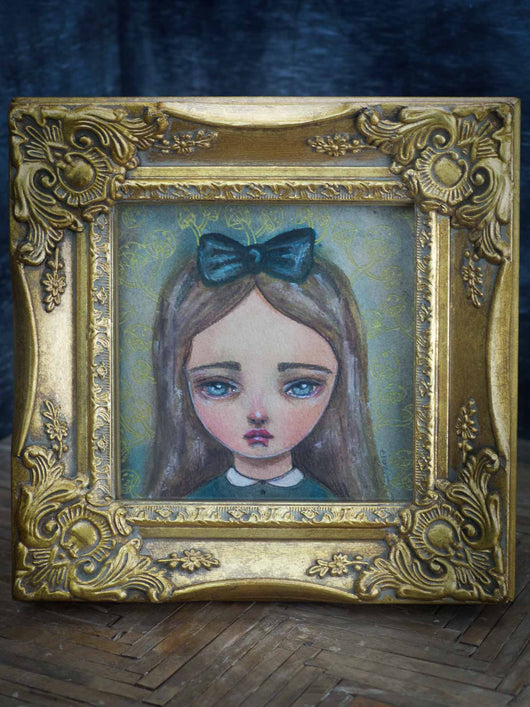 Alice in wonderland is skillfully painted in watercolor on paper by the talented mixed media artist Danita