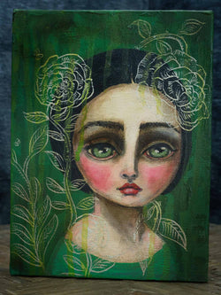 Peony is a beautiful girl with big green eyes painted by Danita in a surreal whimsical style