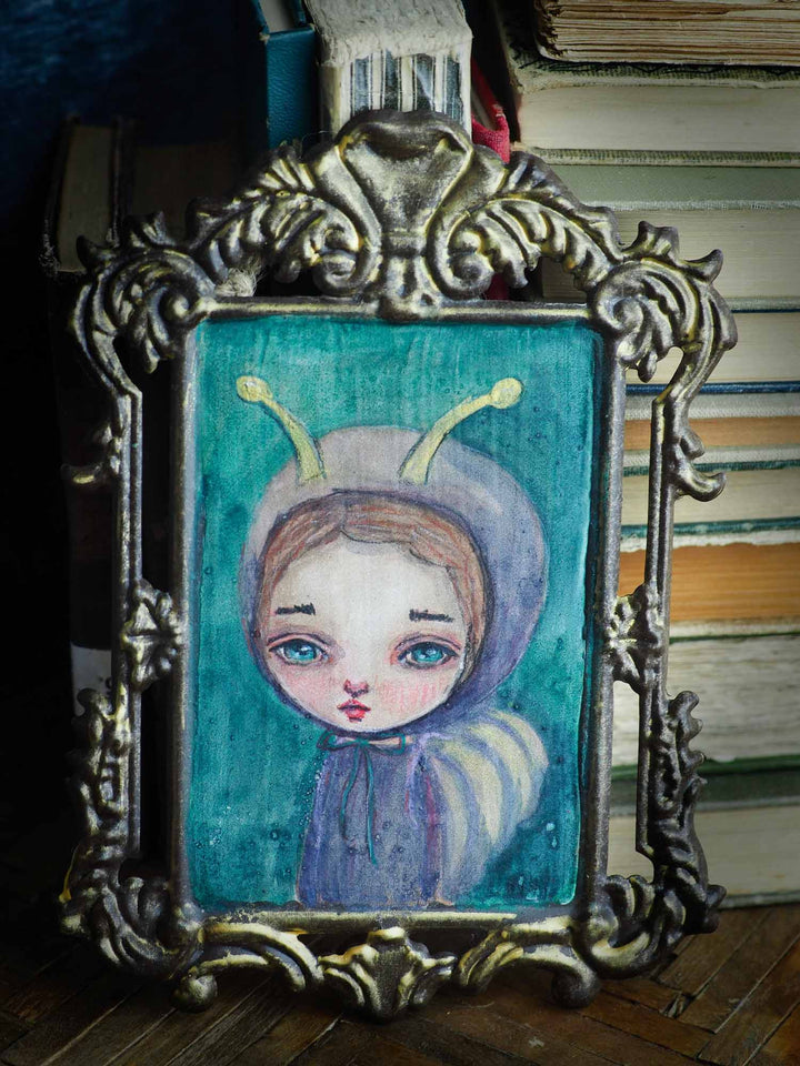 Danita painted a watercolor painting original with a butterfly girl over a metal frame.