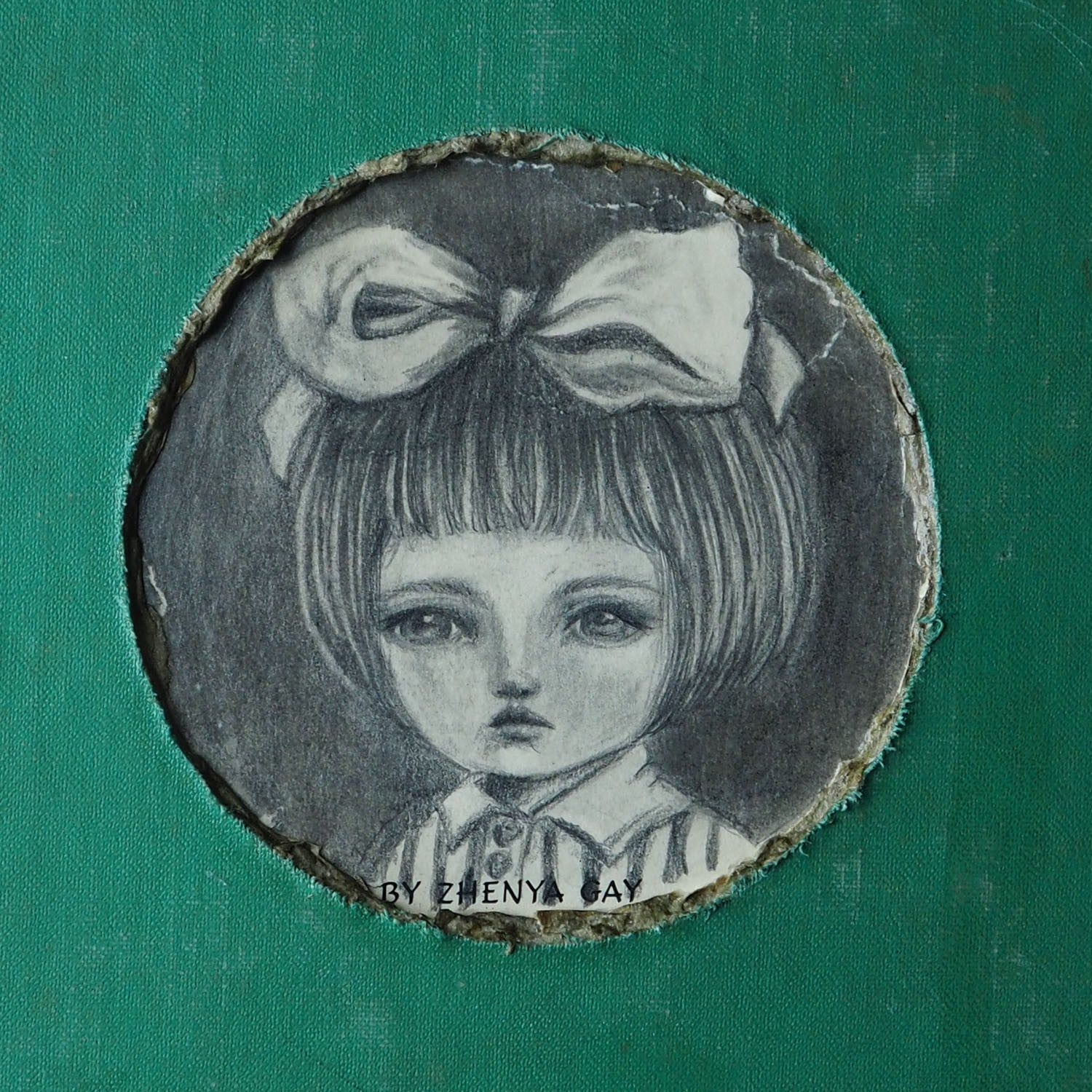 A beautiful mixed media altered book by Danita Art. One of her astonishing girls adorns the cover in a pencil and graphite drawing on the hard cover of an antique library book.