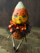 Original Halloween art doll original creation by Danita Art. Paper Clay, sculpted and painted in a spooky whimsical unique work of art. Candy corn Girl.