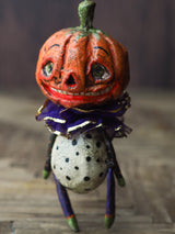 Original Halloween art doll original creation by Danita Art. Paper Clay, sculpted and painted in a spooky whimsical unique work of art. jack-o-lantern pumpkin skull