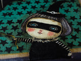 A little makes witch taking her pet bat for a night flight. Danita uses whimsical and surrealist images to create mixed media paintings for Halloween.