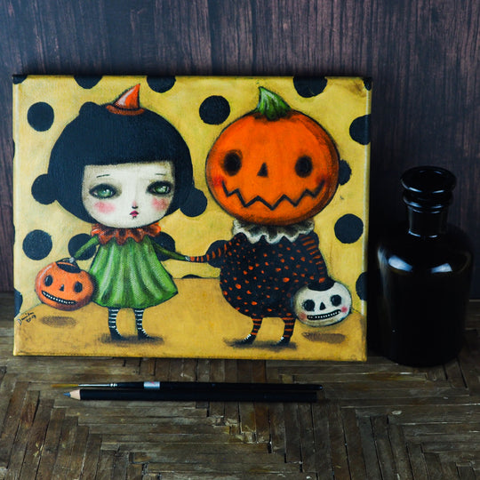 A with and her jack-o-lantern pumpkin friend share candy on this original mixed media acrylic pencil pastel Halloween painting Danita Art. Whimsical home decor.