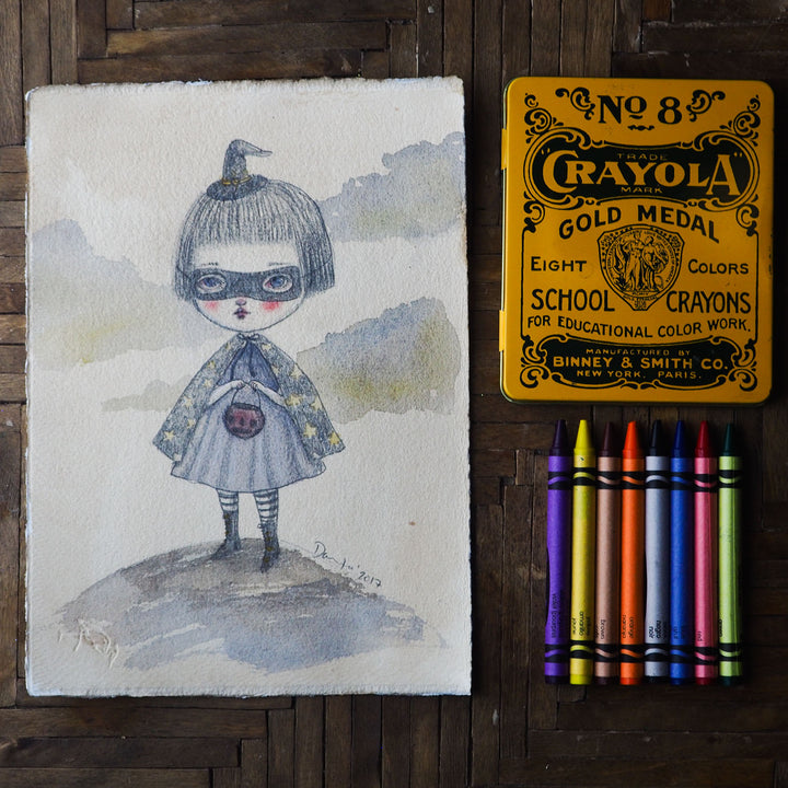 Danita original watercolor pencil painting. Whimsical witch trick-or-treat Halloween night. She has her cape, a mask and a little jack-o-lantern on her hands.